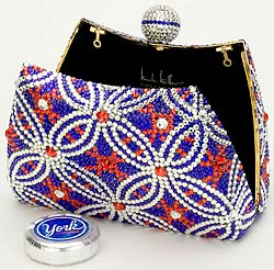 York Peppermint Patties, the official candy of New York Fashion Week (thank goodness for that - I am sick of relying on Atkins bars for sustenance) commissioned designer Nicole Miller to design a purse to match the chocolate. The good news is that this purse was available via eBay and on site through a charity auction. The bad news? It was valued at more than US$2,000. Maybe a candy-wrapper handbag is in order. (photo courtesy of York)