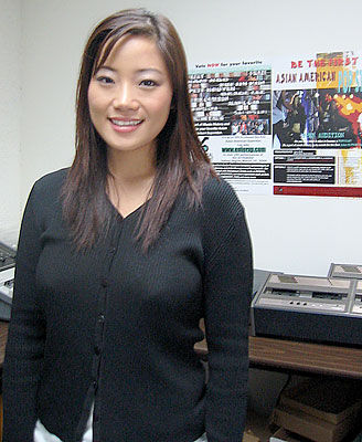 Finalist Catherine Hwang in the Xperimental Entertainment office in Los Angeles. Behind her on the wall are a couple of posters promoting the Asian American Pop Star Contest. (photo by Yuan-Kwan Chan / Meniscus Magazine)