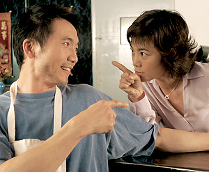"""Collin Chou, left, plays Tony, brother to Yvonne (Sylvia Chang) in """"American Fusion."""" (photo courtesy of the AAIFF)"""