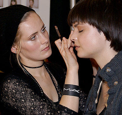 A M.A.C. make-up artist works on model Patricia Schmid. (photo by Bibs Teh / Meniscus Magazine)