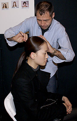 Model Hye Park gets the finishing touches on her hair. (photo by Bibs Teh / Meniscus Magazine)