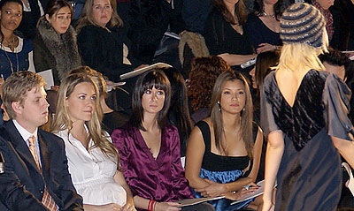 Donald Trump Jr. (left), Vanessa Trump (second from left) and Kelly Hu (second from right) eye a model at the BCBG Max Azria show. (photo by Bibs Teh / Meniscus Magazine)