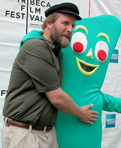 Joe Clokey - son of Gumby creator Art Clokey and also an animator himself - with Gumby, who has a pair of eyes and a nose peeking out of his mouth! His ruse has been discovered!! (photo by Yuan-Kwan Chan / Meniscus Magazine)
