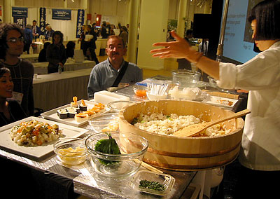 Author and culinary expert Hiroko Shimbo, right, invites attendees to sample some of her sushi creations from a demonstration and lecture at the 2006 Japanese Food & Restaurant Show in New York. (photo by Yuan-Kwan Chan / Meniscus Magazine)