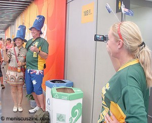 "In the National Indoor Stadium following the women's gymnastics team preliminaries, locals queued to take pictures with an Australian fan. As his companion videotaped the spectacle, I asked her how many people had taken pictures with him. She exclaimed, ""Hundreds!"" (photo by Yuan-Kwan Chan / Meniscus Magazine)"