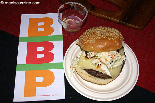 A menu from Bobby's Burger Palace, a salt-rimmed frozen cactus pear margarita, and a Dallas Burger. (photo: Bibs Teh / Meniscus Magazine)