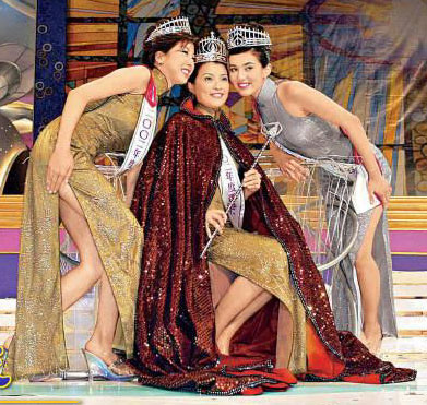 (l-r) The 2002 court. 2nd runner-up: Cathy Wu; Miss Hong Kong 2002: Tiffany Lam; 1st runner-up: Victoria Jolly. (photo courtesy of TVB)