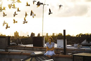 "Zoe Kazan (Ivy) sits on a rooftop in Brooklyn in a scene from Bradley Rust Gray's ""The Exploding Girl."" (Credit: Carolyn Drake)"