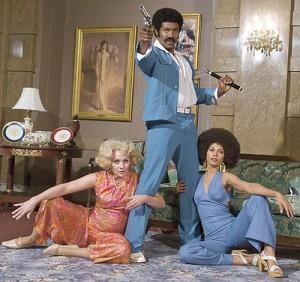 "Black Dynamite (center, played by Michael Jai White) strikes a trademark pose. (photo courtesy of ""Black Dynamite"")"