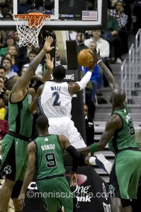 Washington's John Wall drives past a trio of Celtics, including Rajon Rondo (#9) and Kevin Garnett (#5).  (photo by Kwai Chan / Meniscus Magazine)