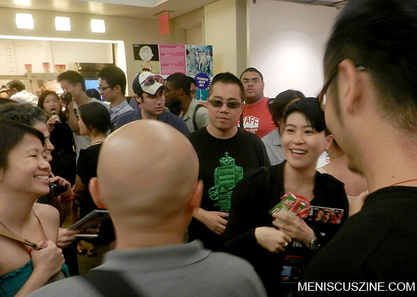 Hong Kong director Pang Ho-Cheung (in the shirt with the green robot) surrounded by fans at the Film Society at Lincoln Center. (photo by Yuan-Kwan Chan / Meniscus Magazine)
