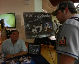 Ron Swoboda of the World Series champion 1969 New York Mets signs autographs and talks to a fan at the quarterly Pepcom tech trade show event on June 21, 2012. (photo: Yuan-Kwan Chan / Meniscus Magazine)