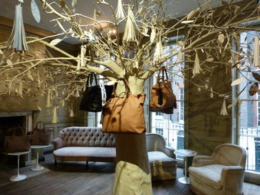 "Details at the Anya Hindmarch presentation included an indoor ""tree"" with bags hanging from its branches. (photo by Yuan-Kwan Chan / Meniscus Magazine)"