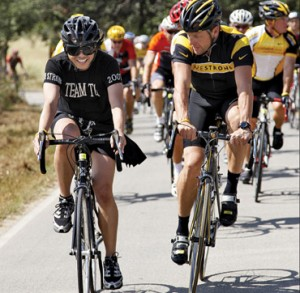 """Zang Toi (left) with Lance Armstrong. Toi biked in Armstrong's """"Race for the Cure"""" in October 2007. (photo courtesy of Zang Toi)"""
