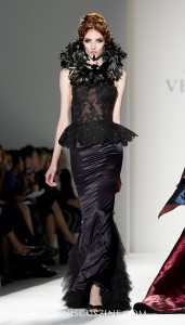 Black lace corset with feather collar, long black velvet skirt (photo by Kwai Chan / Meniscus Magazine)