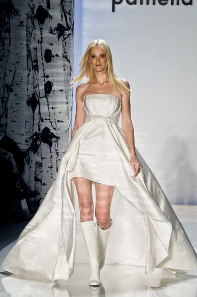 "Carmen Kass models an ""Aspen wedding gown"" in the Pamella Roland Fall 2012 runway show at Lincoln Center. (photo by Bibs Teh / Meniscus Magazine)"