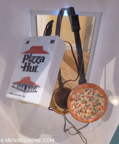 The best accessory to listen to those pizza record tracks converted to MP3s? Why, with these retro Pizza Hut headphones. (photo by Scott Miller / Meniscus Magazine)