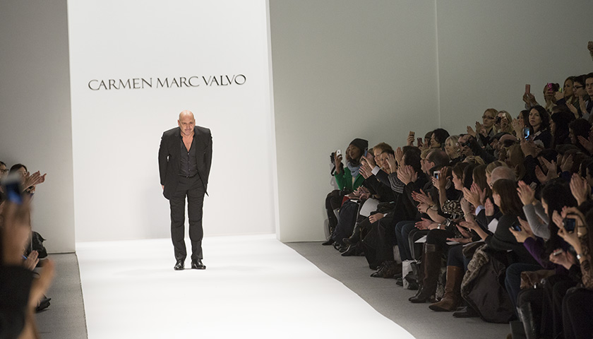 Carmen Marc Valvo takes a bow at the conclusion of his Fall/Winter 2013 runway show in New York. (photo by Kwai Chan / Meniscus Magazine)
