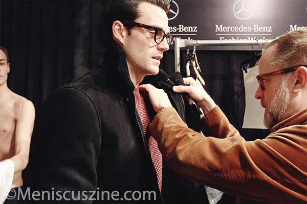 A stylist helps a model prepare for Todd Snyder's presentation at Lincoln Center. (photo Ekaterina Golovinskaya / Meniscus Magazine)