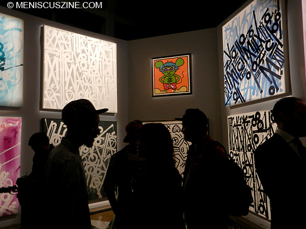 Retna's paintings, influenced by hieroglyphics, surround a Keith Haring print. (photo by Yuan-Kwan Chan / Meniscus Magazine)