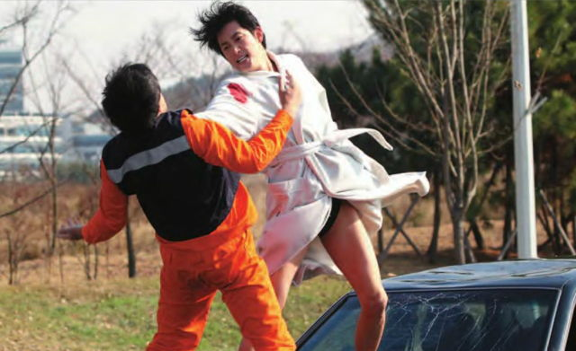 "Better known as a TV star, Park Si-hoo takes on a foe in ""Confession of Murder."" On top of a moving car. While wearing a bathrobe. (photo courtesy of the Film Society of Lincoln Center)"