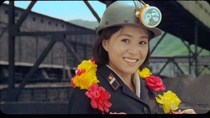 "Externally, Kim Yong Mi looks like a coal miner but internally, she yearns to be an acrobat in ""Comrade Kim Goes Flying."" (photo courtesy of the Melbourne International Film Festival)"