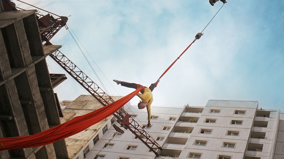 "Real-life trapeze artist Han Jong Sim performs high-risk moves as Kim Yong Mi. (photo courtesy of ""Comrade Kim Goes Flying"")"