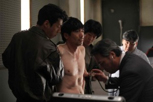 "Park Won-sang (center) plays Kim Jong-tae, the tortured political prisoner in Chung Ji-young's ""National Security."""