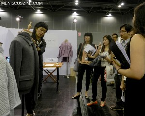 Johanna Ho shows her designs to members of the press at the inaugural THE HUB Hong Kong at the AsiaWorld Expo. (photo by Yuan-Kwan Chan / Meniscus Magazine)