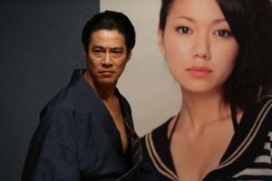 Clouding the judgment of Ikegami (Shinichi Tsutsumi): his opposing yakuza clan head's daughter, Mitsuko (Fumi Nikaido). (photo courtesy of the Busan International Film Festival)