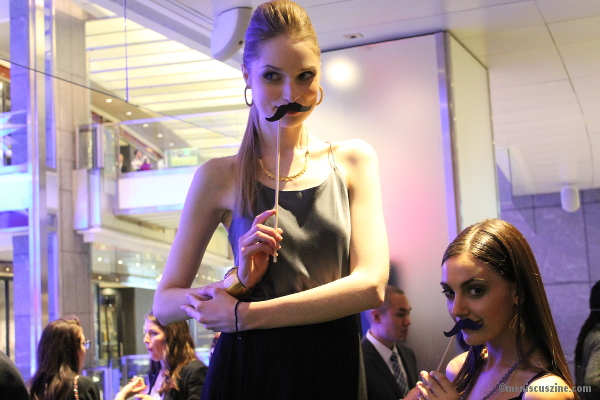 Models get cheeky at the Satya Jewelry Flagship grand opening on Nov. 21. (photo by Shelly Xu / Meniscus Magazine)