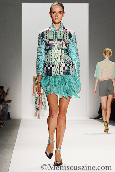 Custo Barcelona Spring 2014: An aqua feathered miniskirt paired with a metallic biker jacket. (photo by Ekaterina Golovinskaya / Meniscus Magazine)