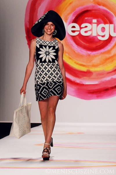 Isabella Rossellini's favorite outfit of the Desigual Spring 2014 runway show in New York: a geometrical black and white dress with white studded shopping bag, modeled by Tali Lennox (daughter of singer Annie Lennox). (photo by Ekaterina Golovinskaya / Meniscus Magazine)