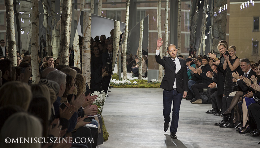 Artistic Director BOSS Womenswear Jason Wu greets spectators at the end of his Fall 2014 New York Fashion Week show. Actresses Diane Kruger and Reese Witherspoon stand and applaud to the right. (photo by Kwai Chan / Meniscus Magazine)