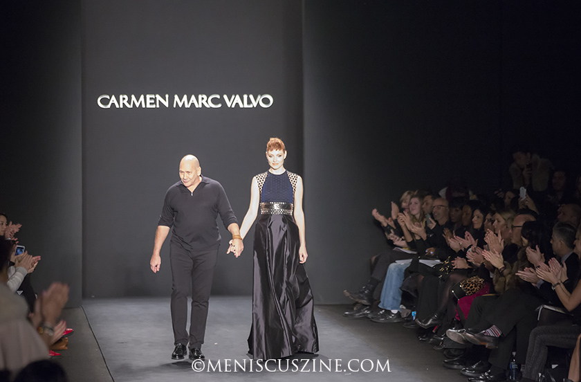 Designer Carmen Marc Valvo (left) with one his models at the conclusion of his Fall 2014 runway show at New York Fashion Week. (photo by Kwai Chan / Meniscus Magazine)