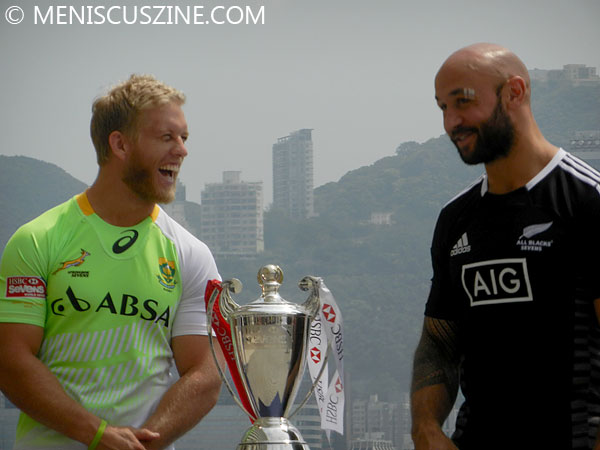 Kyle Brown (South Africa) and DJ Forbes (New Zealand) have a laugh over the championship trophy. (photo by Yuan-Kwan Chan / Meniscus Magazine)