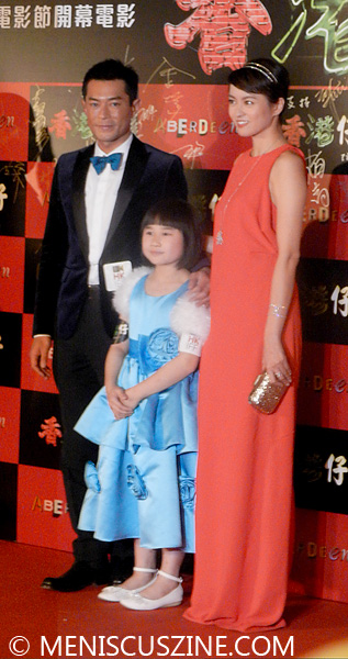 "Gigi Leung, Lee Man Kwai and Louis Koo hit the red carpet at the world premiere of ""Aberdeen,"" in which the three actors play a family. (photo by Yuan-Kwan Chan / Meniscus Magazine)"