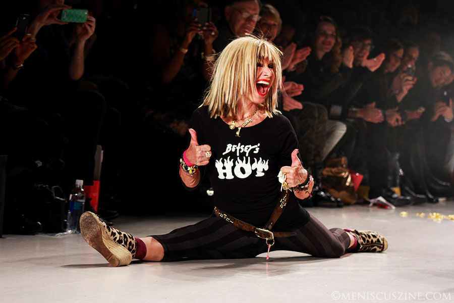 Designer Betsey Johnson does the splits at the end of her Fall 2014 runway show at Lincoln Center. (photo by Ekaterina Golovinskaya / Meniscus Magazine)