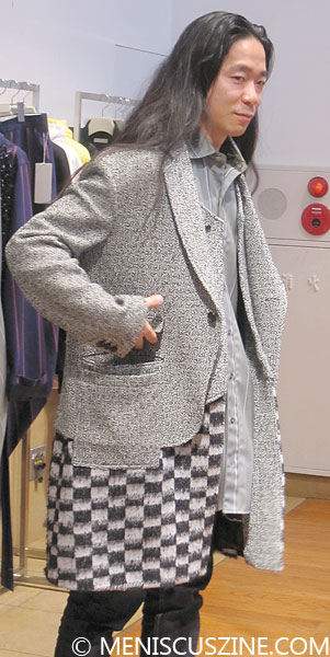 Facetasm designer Hiromichi Ochiai models a bi-colored checkered and grey printed jacket at an exhibition in Daikanyama. (photo by Megan Lee / Meniscus Magazine)