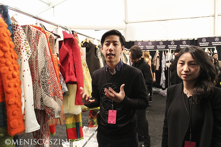 Ernest Huang (left) (M.F.A., Fashion Design) at Lincoln Center before the Academy of Art University Fall 2014 show. Huang is currently an intern for Yigal Azrouël. Huang collaborated with Hong Ni (right) (M.F.A., Textile Design) on a women's collection for the show. (photo by Shelly Xu / Meniscus Magazine)
