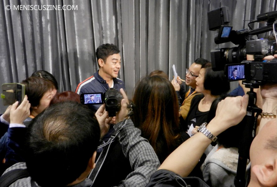 "Lau Ching-wan speaks to reporters after the conclusion of the ""Overheard 3"" press event during the 2014 Hong Kong International Film Festival. (photo by Yuan-Kwan Chan / Meniscus Magazine)"