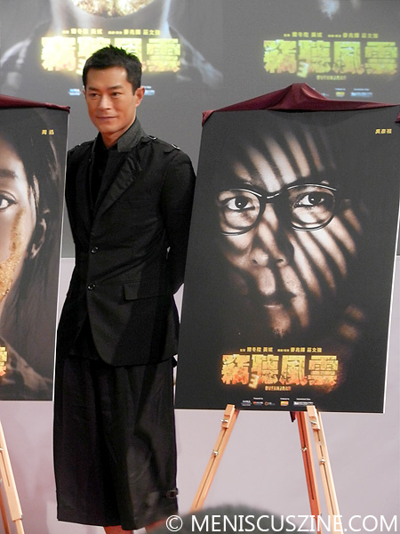 "Louis Koo alongside Daniel Wu's character poster for ""Overheard 3."" (photo by Yuan-Kwan Chan / Meniscus Magazine)"