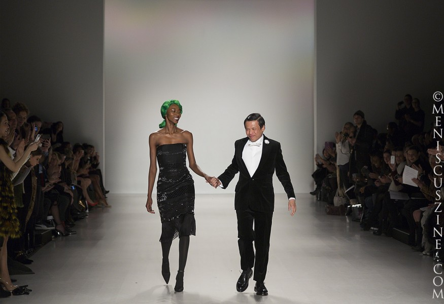 Zang Toi (right) and model Georgie Badiel at the conclusion of the designer's Fall 2014 runway show in New York. (photo by Kwai Chan / Meniscus Magazine)