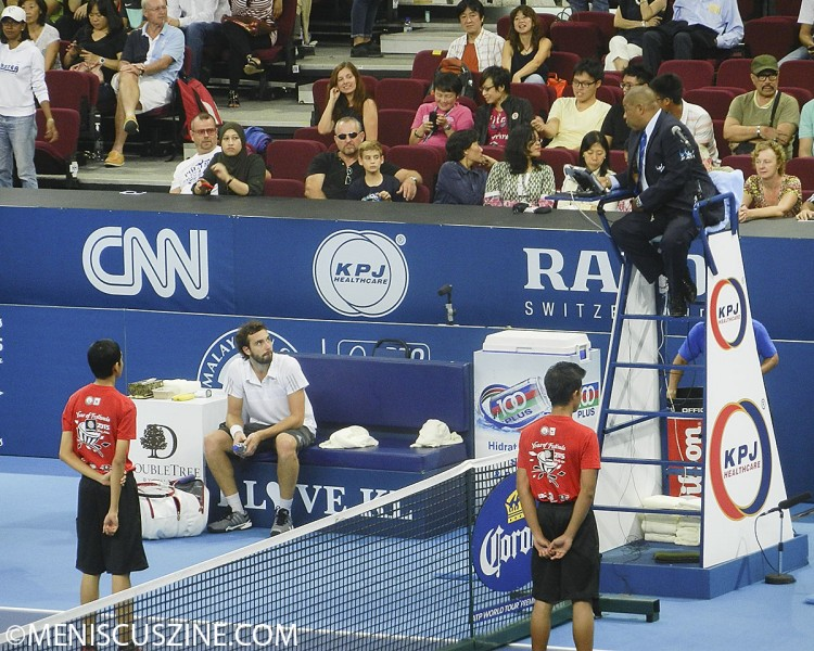 "Ernests Gulbis, nicknamed ""The Outspoken One"" in various promotional materials for the tournament, argues with the umpire during a changeover. (photo by Yuan-Kwan Chan / Meniscus Magazine)"