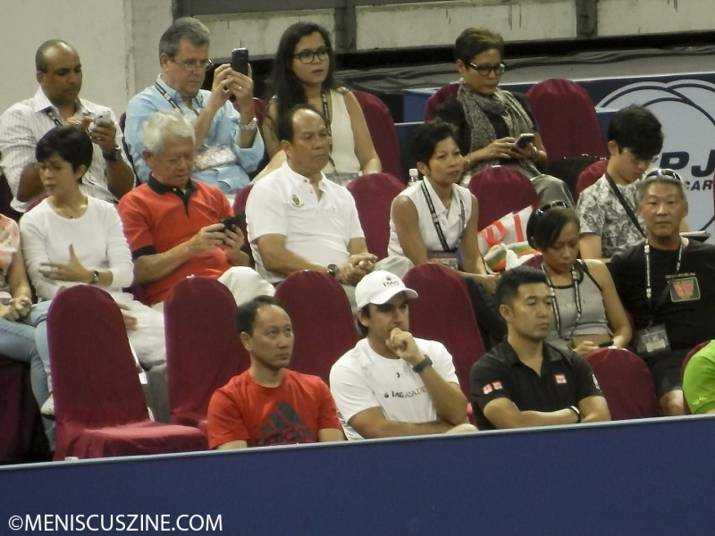 In the crowd for their student's match: part-time coach Michael Chang (front row, left) and Kei Nishikori's full-time coach in Florida, Dante Bottini. (photo by Yuan-Kwan Chan / Meniscus Magazine)
