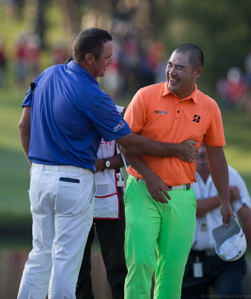 Scott Hend (left) won the 2014 Hong Kong Open on the first hole during the playoff, sinking a putt for par as runner-up Angelo Que (right) finished with a bogey. (photo by Christiaan Hart / Meniscus Magazine)