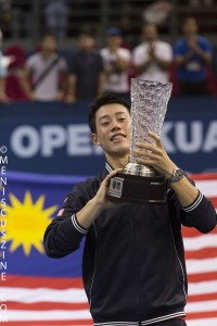 Kei Nishikori juggles the 2014 Malaysian Open singles trophy. The win in Kuala Lumpur was Nishikori's third title of the year following triumphs in Memphis and Barcelona. (photo by Christiaan Hart for Meniscus Magazine)