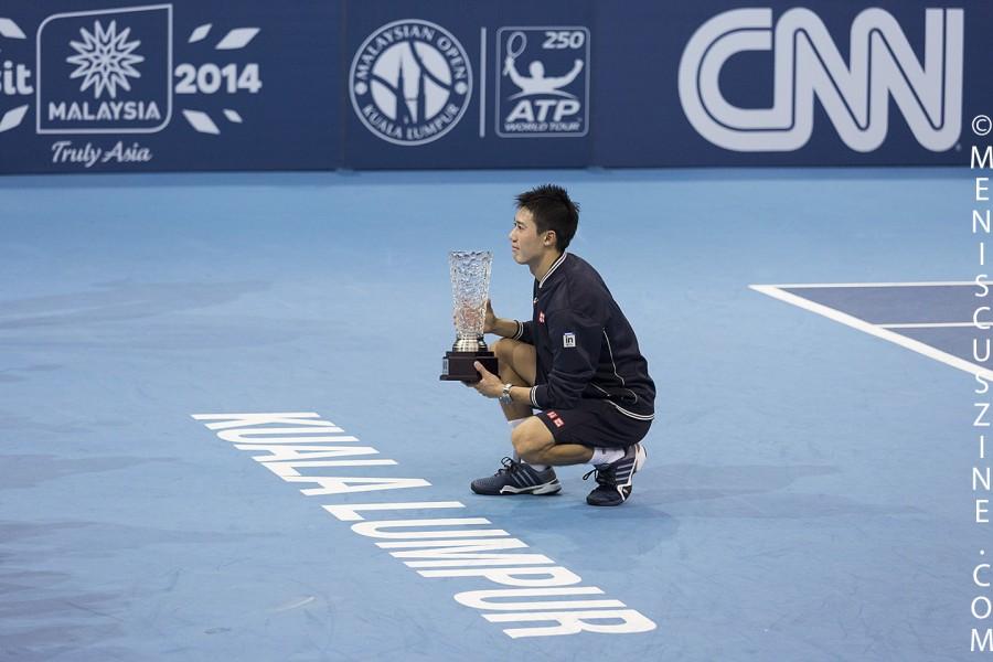 Kei Nishikori's run to the 2014 Malaysian Open championship - his sixth career singles title - included wins over Rajeev Ram, Marinko Matosevic, Jarkko Nieminen and Julien Benneteau. (photo by Christiaan Hart for Meniscus Magazine)
