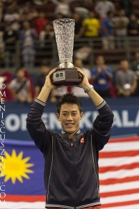 Kei Nishikori holds the trophy aloft after winning the 2014 Malaysian Open. (photo by Christiaan Hart for Meniscus Magazine)