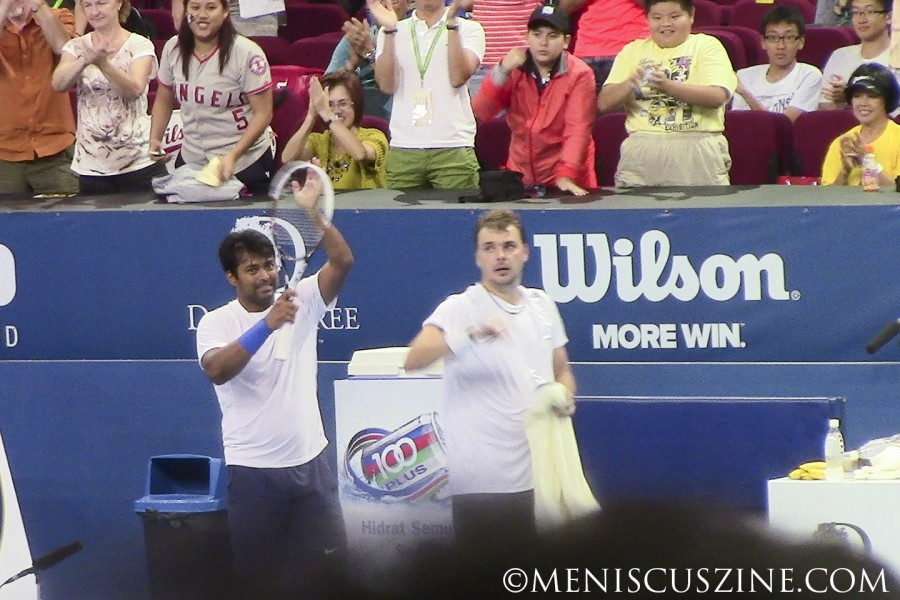 Leander Paes and Marcin Matkowski acknowledge the crowd after winning the 2014 Malaysian Open doubles title. (photo by Yuan-Kwan Chan / Meniscus Magazine)